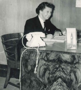 Miss Barbara Brown in charge of the Travel Bureau in the Queen Elizabeth