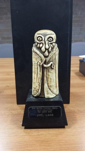 British Fantasy Award for best collection, awarded to Joel Lane's 'The Earth Wire' (1994). The award represents Cthulhu, the fictional entity created by H. P. Lovecraft.