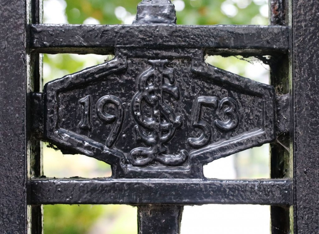 Charles Sydney Jones' initials on his Memorial Gates, Abercromby Square.