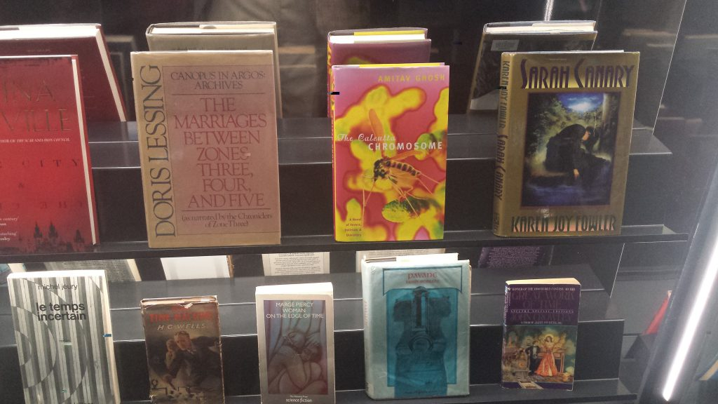 "Books from the Science Fiction Foundation Collection on display at the Barbican Centre's ""Into the Unknown"" exhibition."