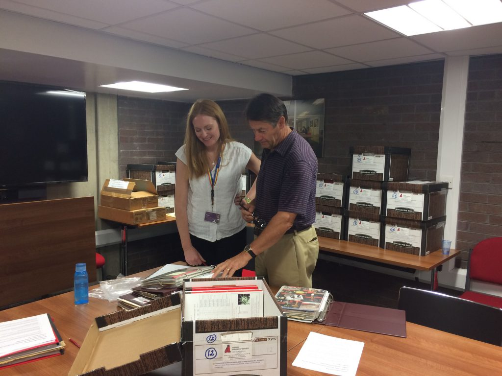 Archivist Beth Williams and John Langley looking at archive material
