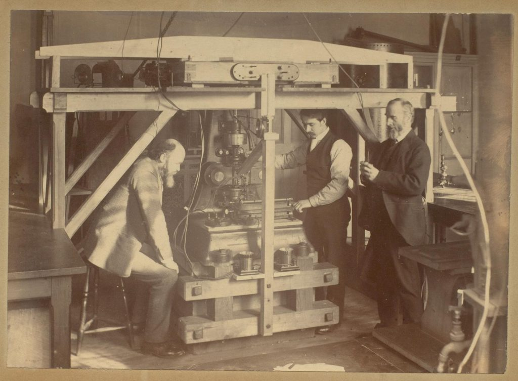 Professor Oliver Lodge, Mr Benjamin Davies, and Mr George Holt with an Ether machine