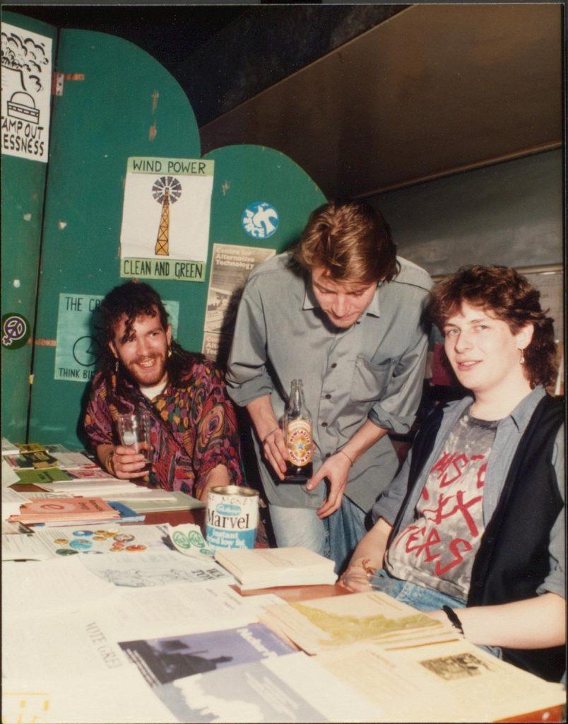 Students at the environmental society table