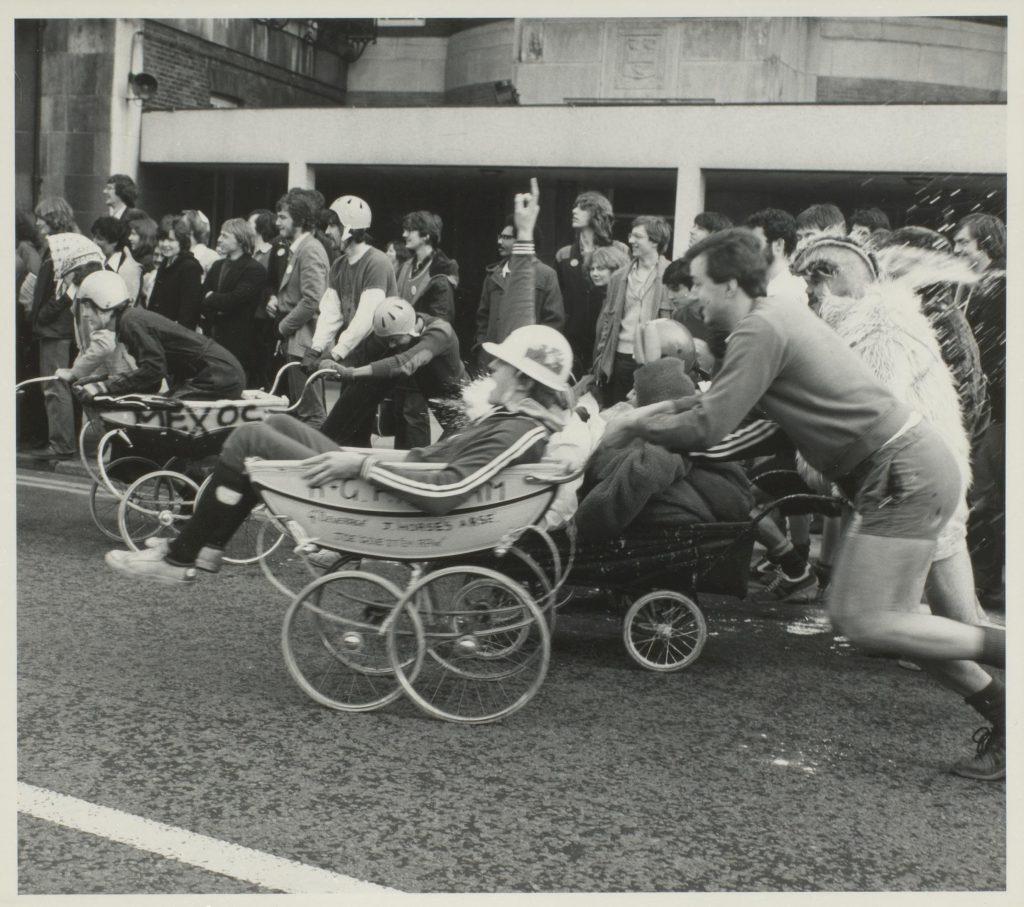 students in panto day pram race